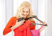 Lovely woman with clothes — Stock Photo