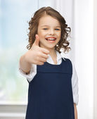 Pre-teen girl showing thumbs up — Stock Photo