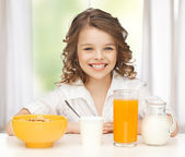 Girl with healthy breakfast — Stock Photo