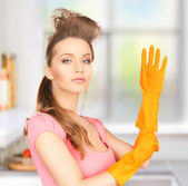 Housewife with protective gloves — Stock Photo