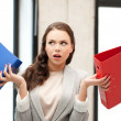 Unsure thinking or wondering woman with folder — Stock Photo #21977249