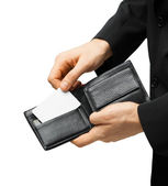 Man in suit holding credit card — Stock Photo