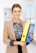 Beautiful woman with folders — Stockfoto