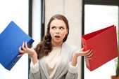 Unsure thinking or wondering woman with folder — Stock Photo