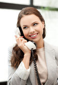 Businesswoman with cell phone calling — Stockfoto
