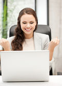Smiling businesswoman celebrating victory or win — Stock Photo