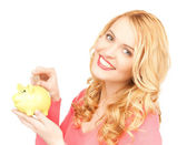 Woman with piggy bank and cash money — Stock Photo