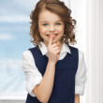Pre-teen girl showing hush gesture — Stock Photo