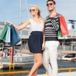 Young couple in duty free shop - Stock Photo