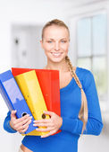 Young attractive businesswoman with folders — Stok fotoğraf