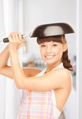 Housewife with frying pan — Stock Photo