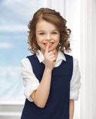 Pre-teen girl showing hush gesture — Stock Photo
