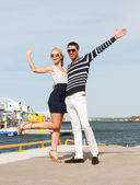 Couple standing and waving in port — Stock Photo