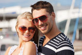 Happy young couple in port — Foto Stock