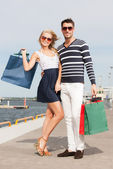 Young couple in duty free shop — Stock Photo