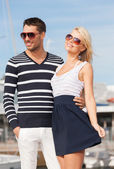 Happy young couple in port — Stockfoto