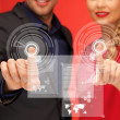 Man and woman pressing virtual button — Stock Photo