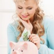 Woman with piggy bank and cash money — Stock Photo #22186113