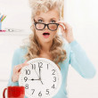 Stock Photo: Wondering businesswoman with clock