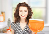 Beautiful woman with brush and pan — Stock Photo