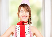 Party girl with gift box — Stock Photo