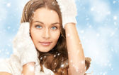 Beautiful woman in white gloves — Stock Photo