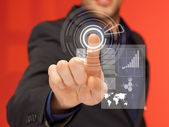 Handsome man in suit pressing virtual button — Stockfoto
