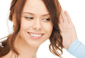 Happy woman listening gossip — Stock Photo