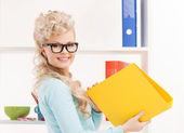 Beautiful smiling woman with folder — Stock Photo