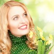 Lovely woman with yellow flowers and butterflies - Stock Photo