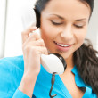 Stock Photo: Businesswomwith rotary phone calling