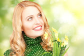 Lovely woman with yellow flowers and butterflies — Stock Photo