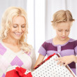 Mother and little girl with gifts — Stock Photo