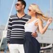 Happy young couple in port — Stock Photo #22279299