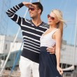 Happy young couple in port — Stock Photo #22279317