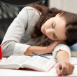 Stock Photo: Bored and tired woman sleeping on the table
