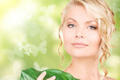 Woman with green leaf and butterflies — Stock Photo
