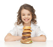 Little girl with junk food — Stock Photo