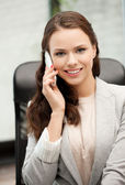 Businesswoman with cell phone calling — Stock Photo