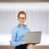 Happy woman with laptop computer — 图库照片