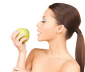 Woman in with an apple — Stock Photo