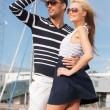 Happy young couple in port — Stock Photo #22526983