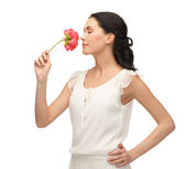 Young and beautiful woman smelling flower — Stock Photo