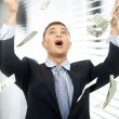 Businessman in money rain indoors - Stock Photo