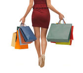 Long legs with shopping bags — Stock Photo