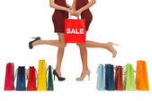 Long legs with shopping bags — Stockfoto
