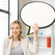 Smiling businesswoman with blank text bubble — Stock Photo #22766612