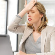 Businesswoman holding her head with hand — Stock Photo #22766674
