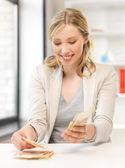 Businesswoman with euro cash money — Stock Photo