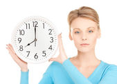 Businesswoman with wall clock — Stock Photo
